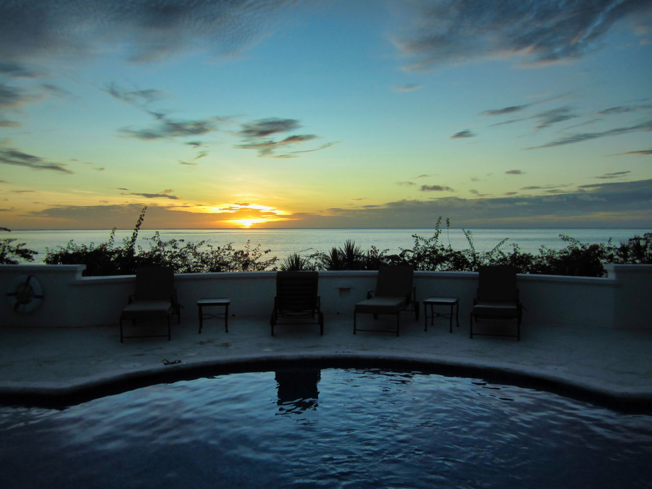 Sunset over the villa's pool
