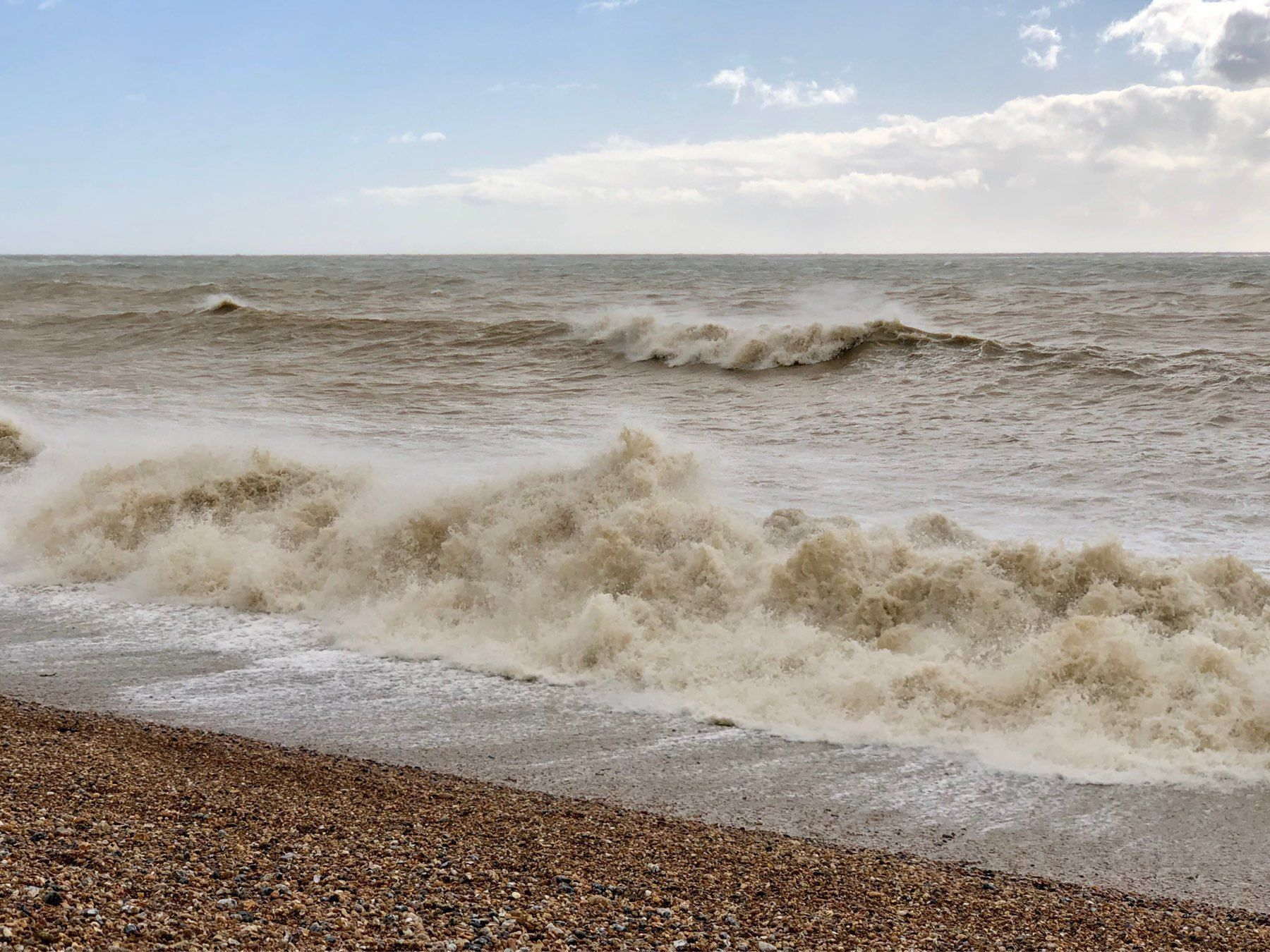 Waves crashing onto Shoreham Beach in Sussex.