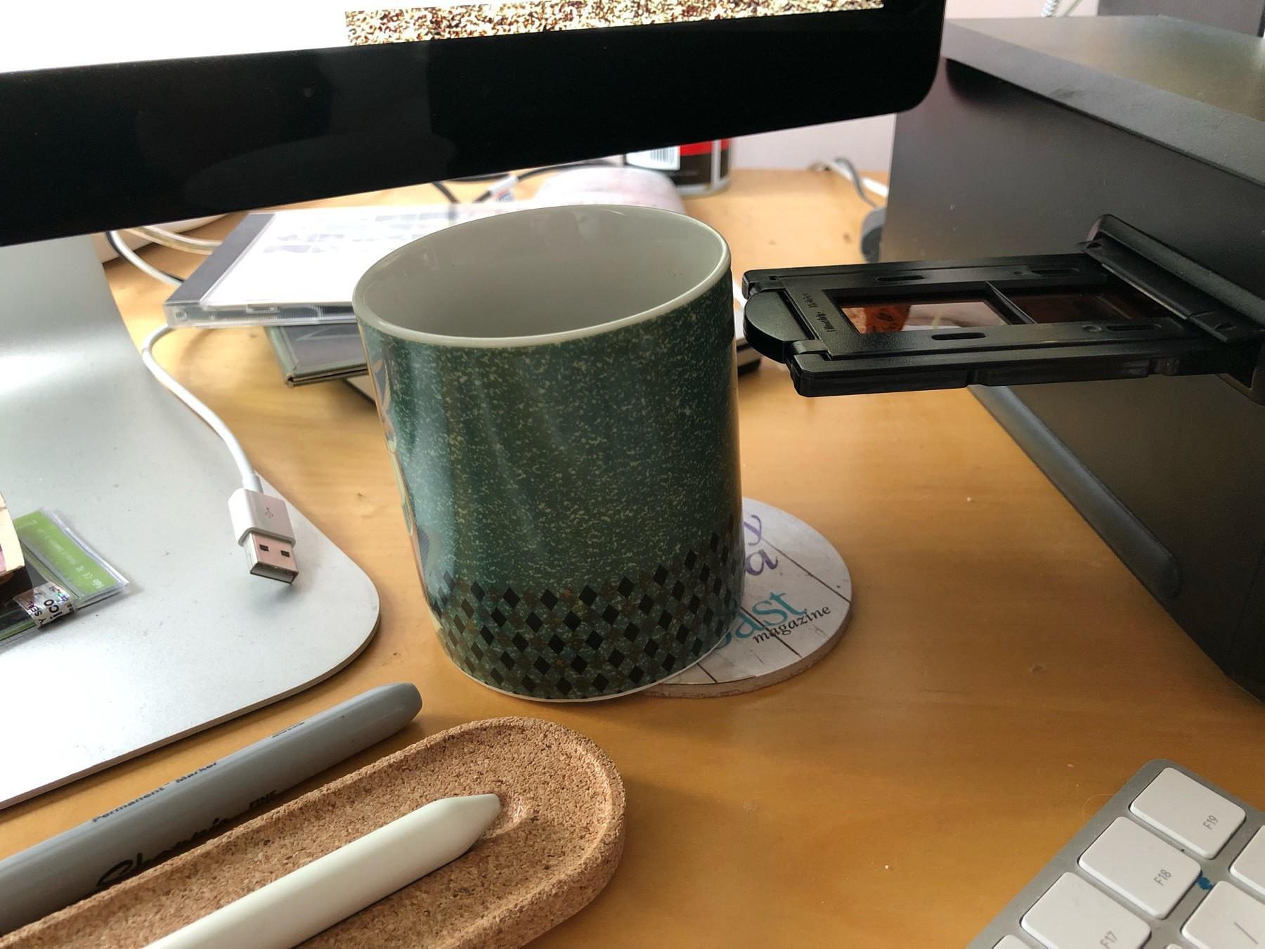My coffee mug being knocked by my film scanner
