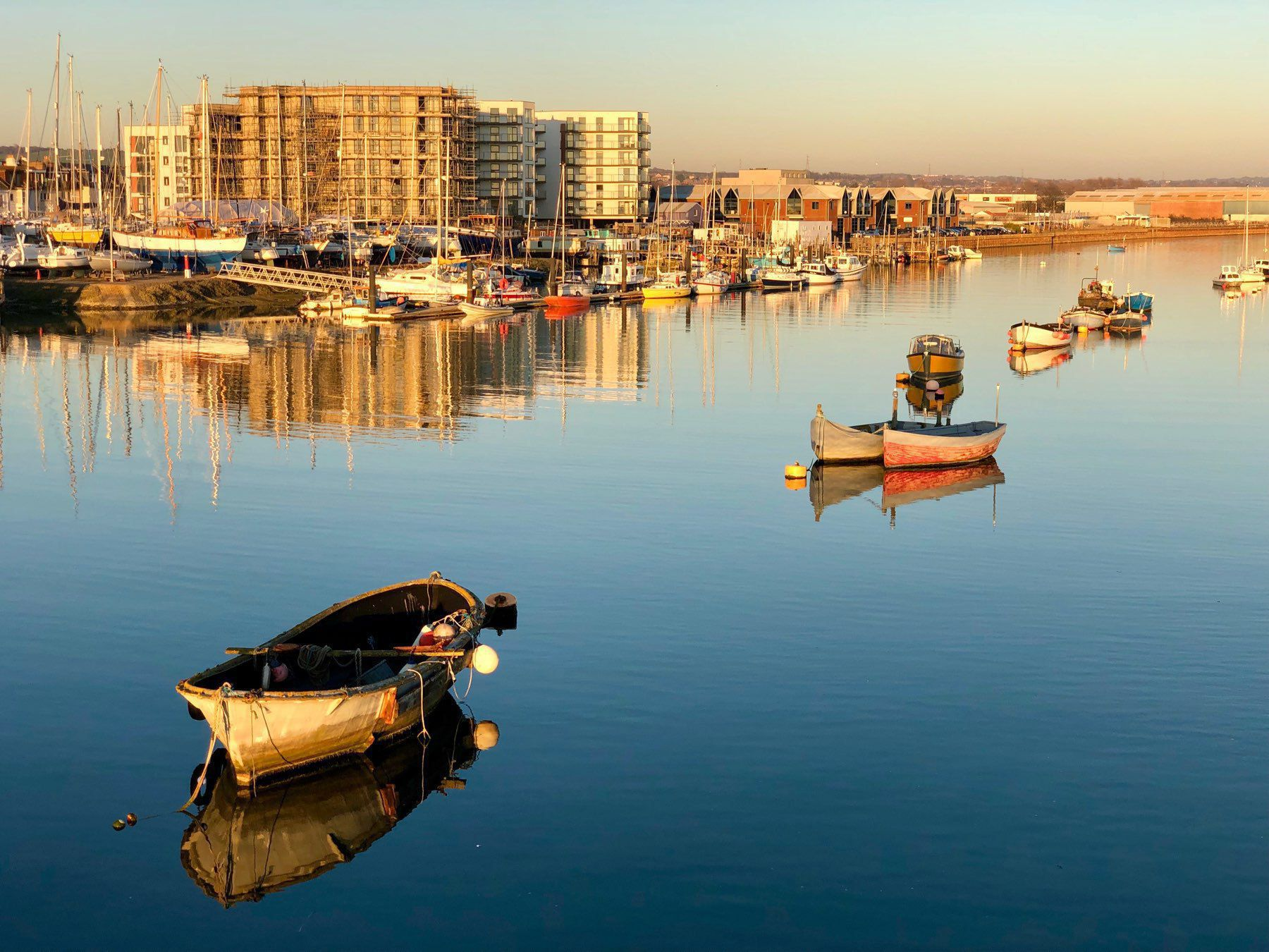 Evening light on boats in the river Adur