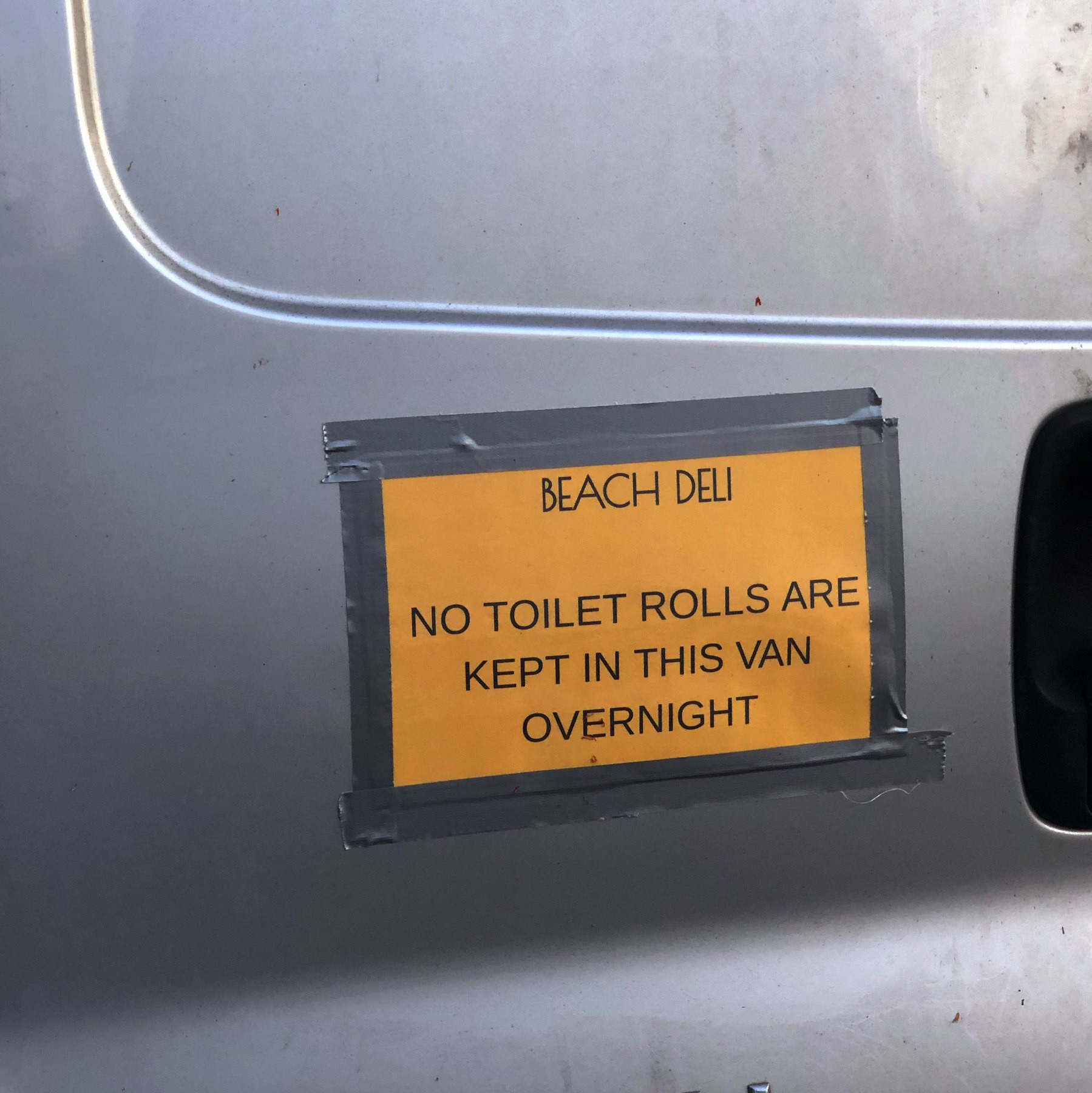 A sign on a van saying that no toilet rolls are stored there overnight.