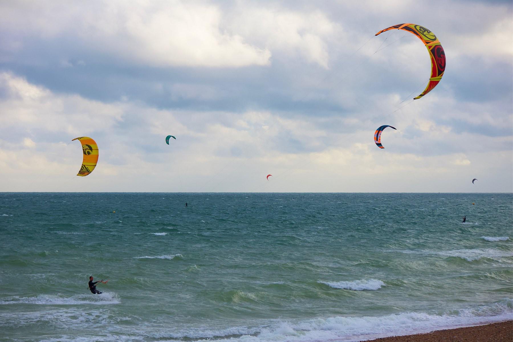 Kitesurfers in the sea off Shoreham Beach, West Sussex