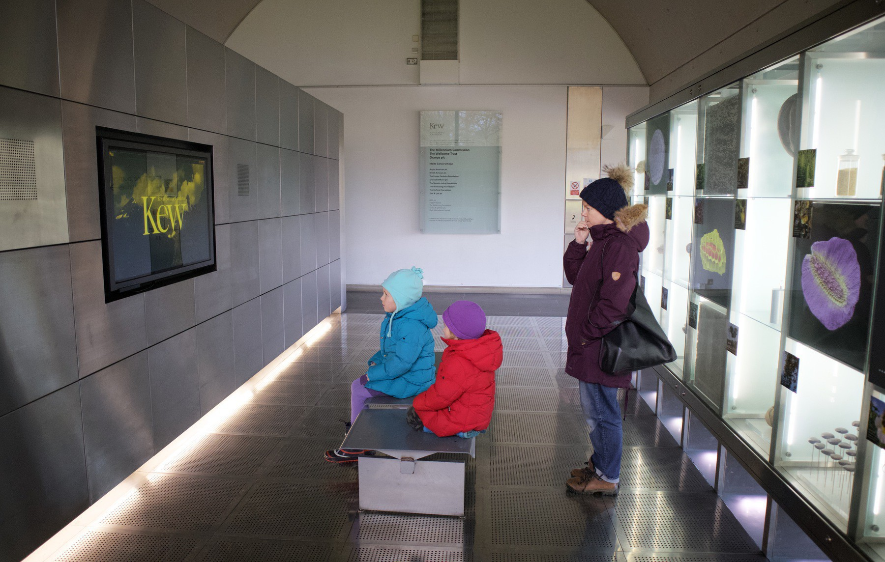 The family watching a video at the Millenium Seed Bank