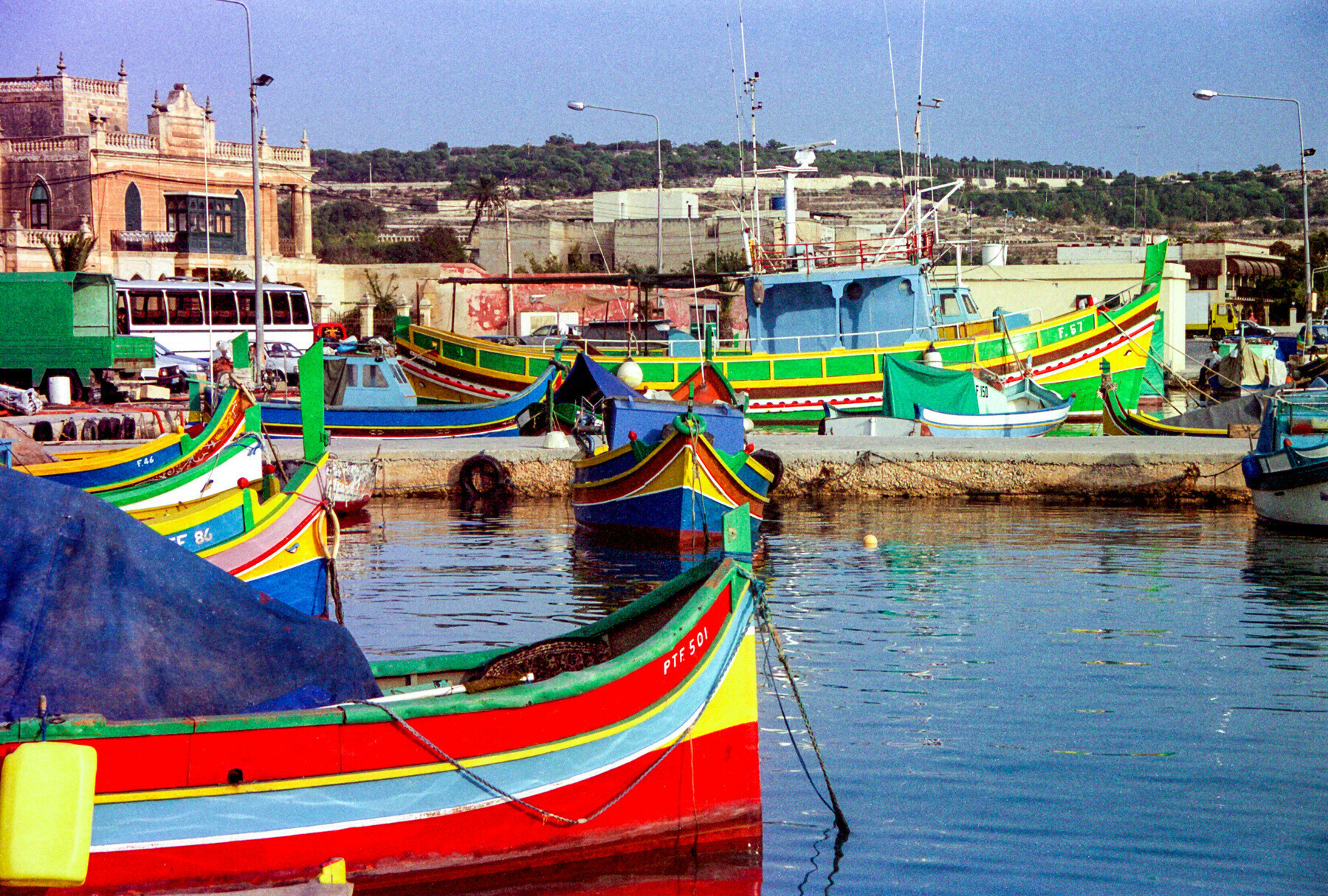 Colourful boats in a harbour in Malta.