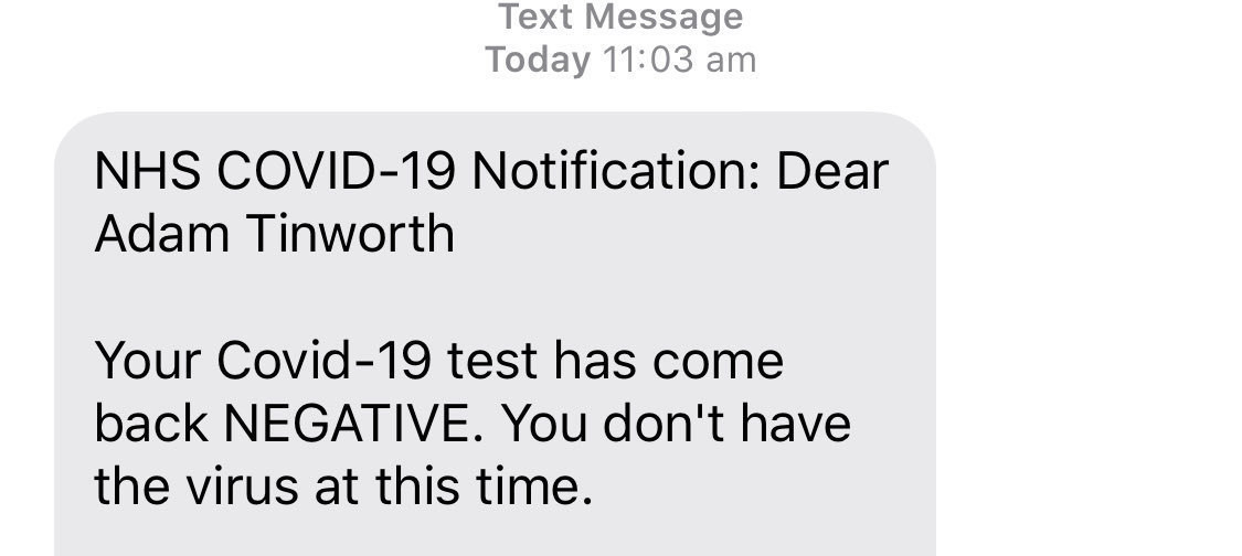 A UK government text message showing a Covid-19 test result.