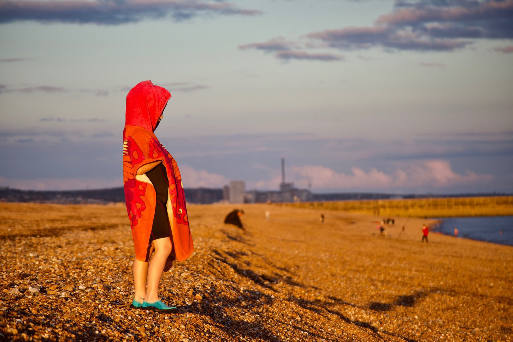 A young girl on Shoreham Beach after her sea swim.