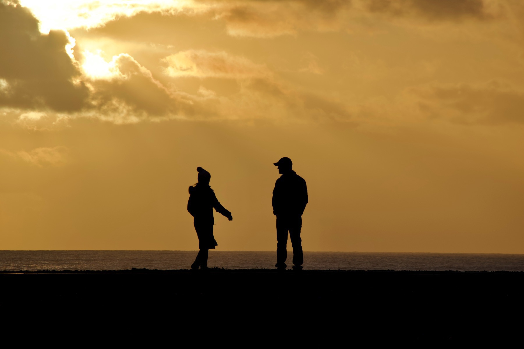 Silhouette of a couple on Shoreham Beach.