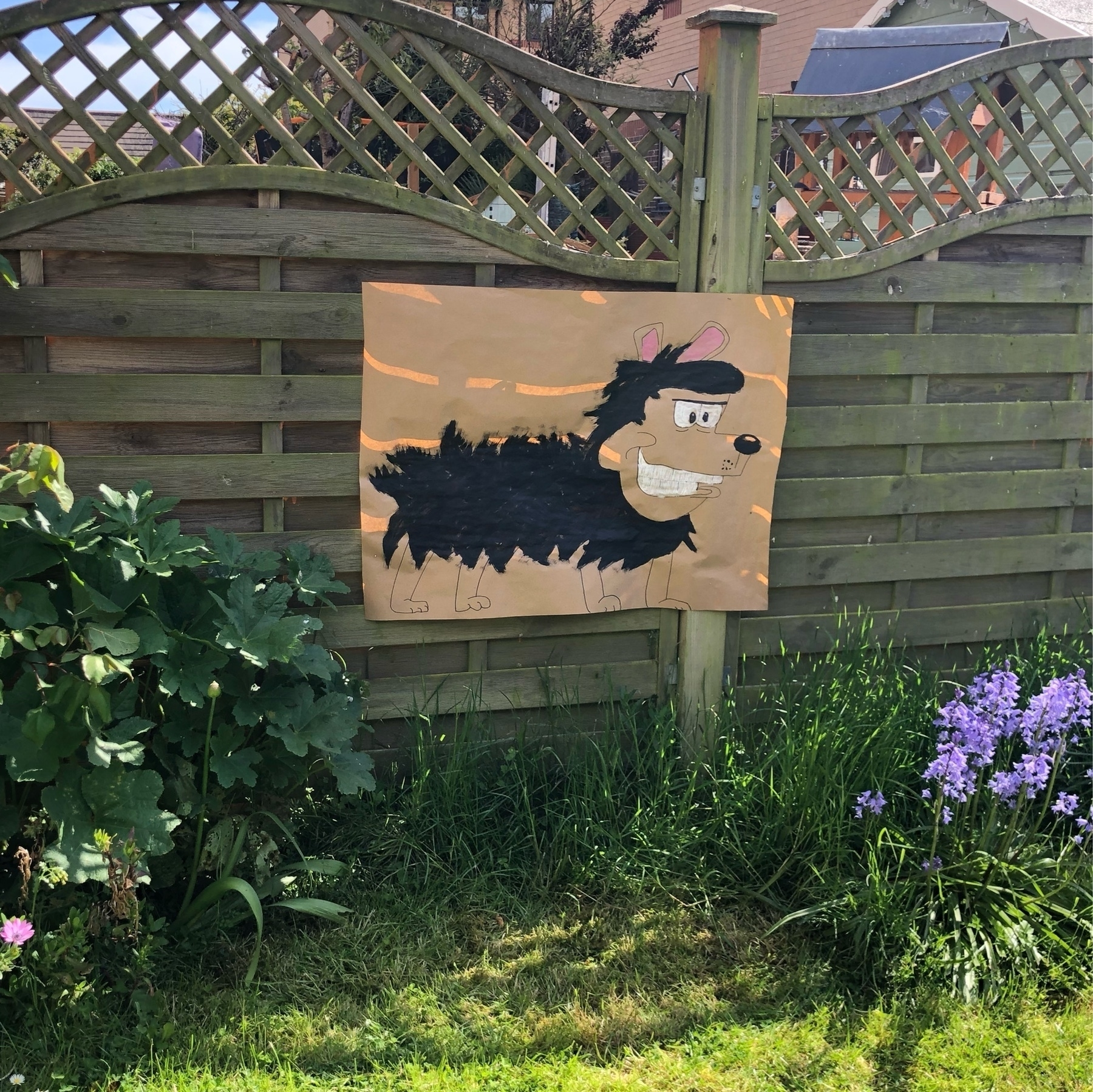 """A drawing of the Beano's Gnasher, teady for a """"pin the tail"""" game."""