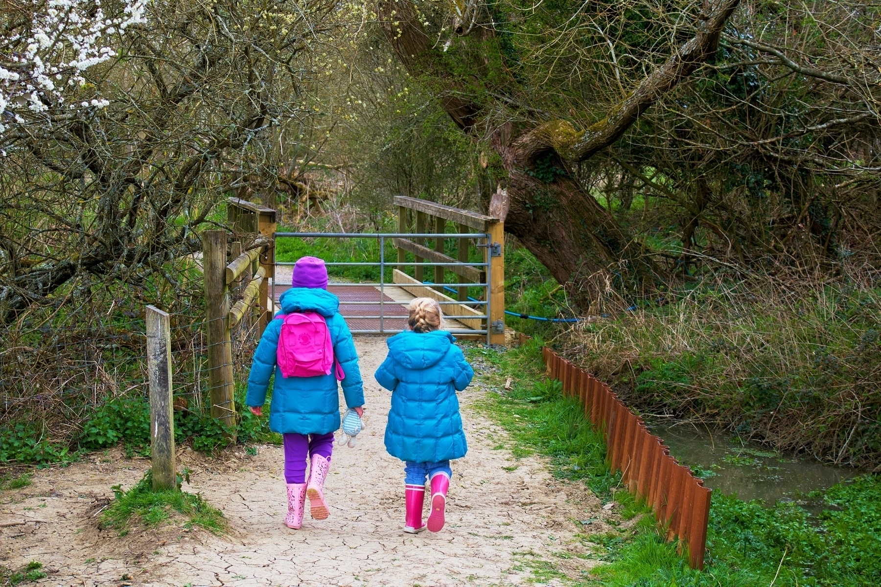 Two younb girls walking at Woods Mill in Sussex.