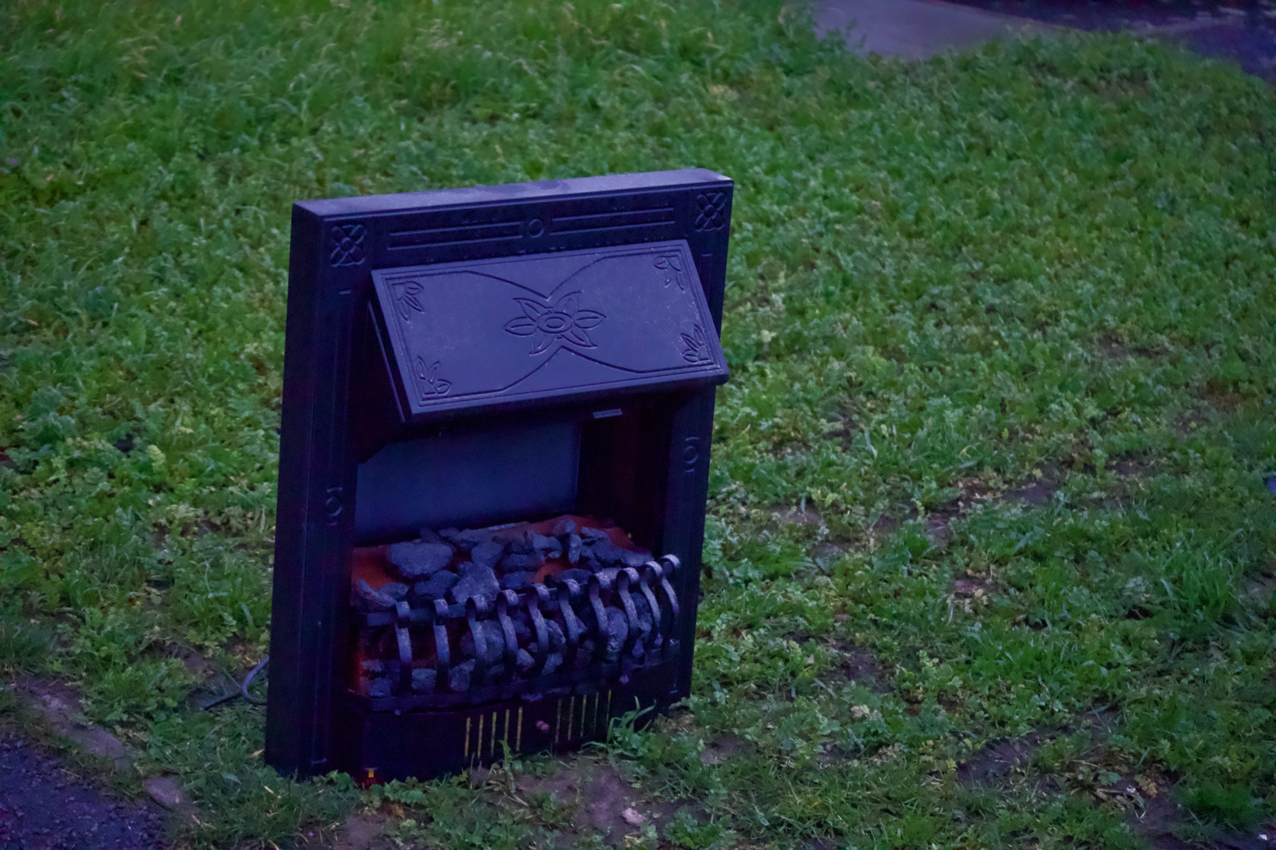 A fireplace sitting on a lawn.