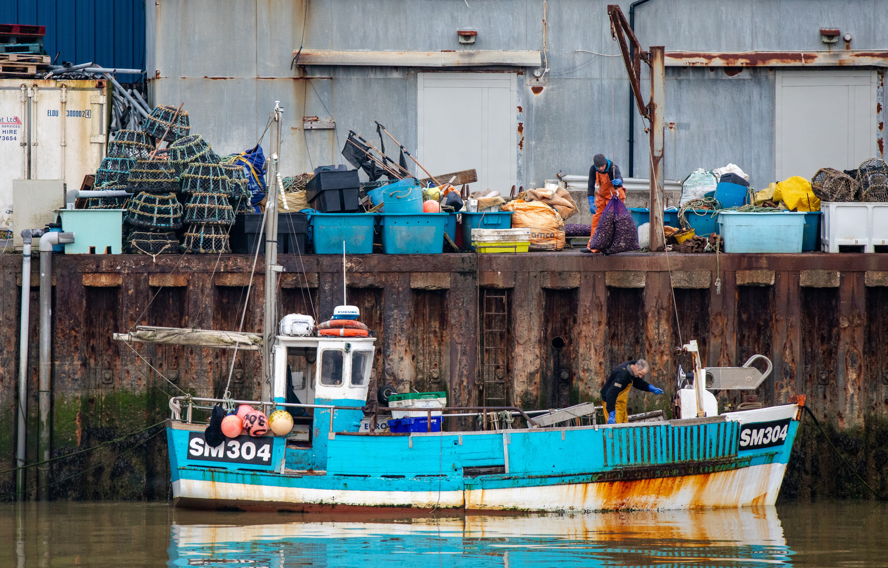 A fishing boat in the Adur bringing in a catch.